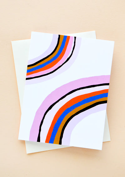 A white greeting card and envelope. Card features vibrant rainbow illustration on front.