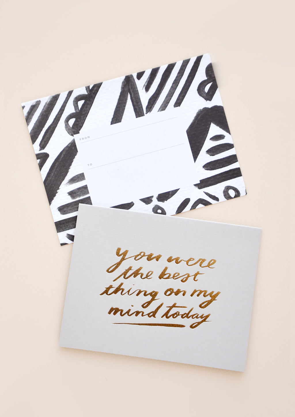 "2: Grey greeting card with ""You were the best thing on my mind today"" in gold foil. Shown with black and white patterned envelope."
