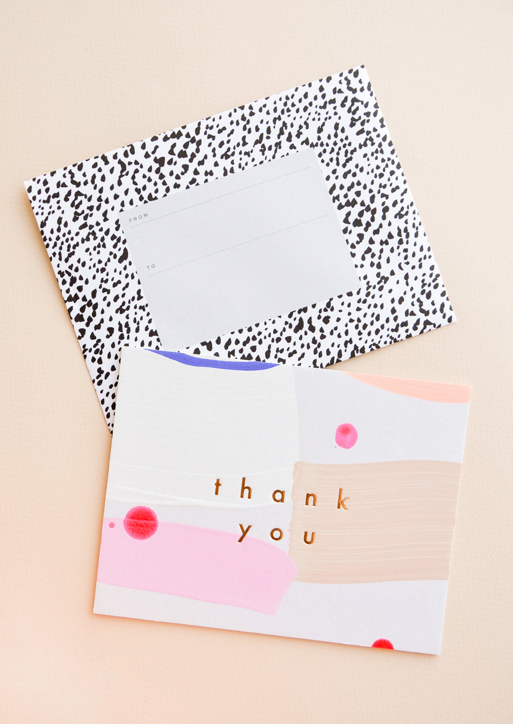 "2: Hand painted card in colorful abstract pattern with gold foil ""Thank you"" text, paired with black and white printed envelope"