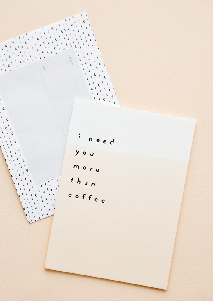 "1: Notecard with pale watercolor peach wash and the text ""I Need You More Than Coffee"" and dotted envelope."