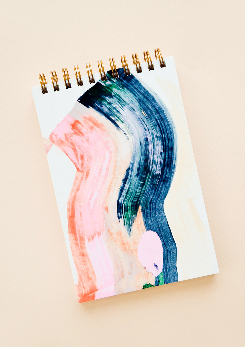 1: Cover of a spiral notebook, decorated with painted colors pink and blue.