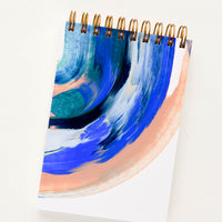 1: Pocket-size spiral bound notebook with handpainted cover in blue and peach paint swirl