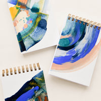 2: Small, pocket-size spiral notepads with covers painted in earth toned paint swirls