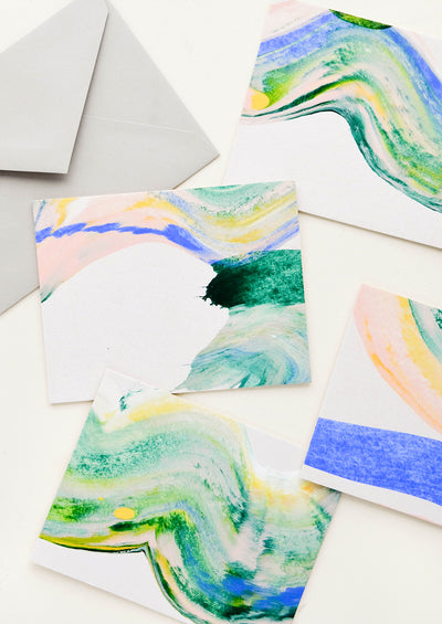 Hand painted all-purpose greeting cards with blue-green paint swirl patterns, each one unique.