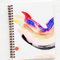 1: A hardcover, spiral bound notebook with a rainbow swirl, hand-painted cover.