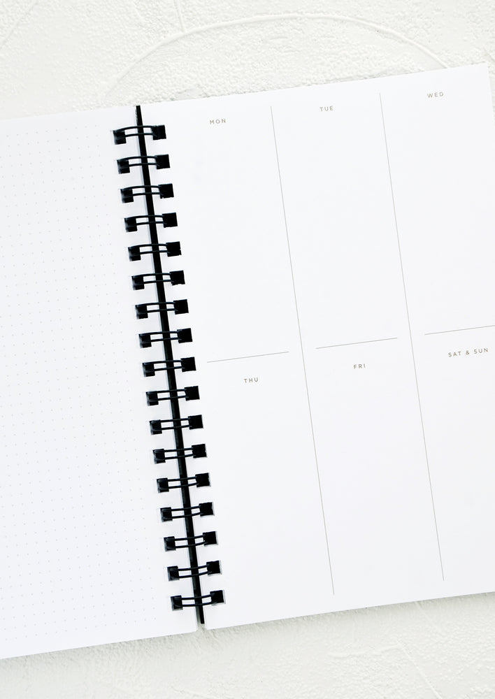 2: Interior pages of spiral bound planner with blocked off boxes for every day of the week