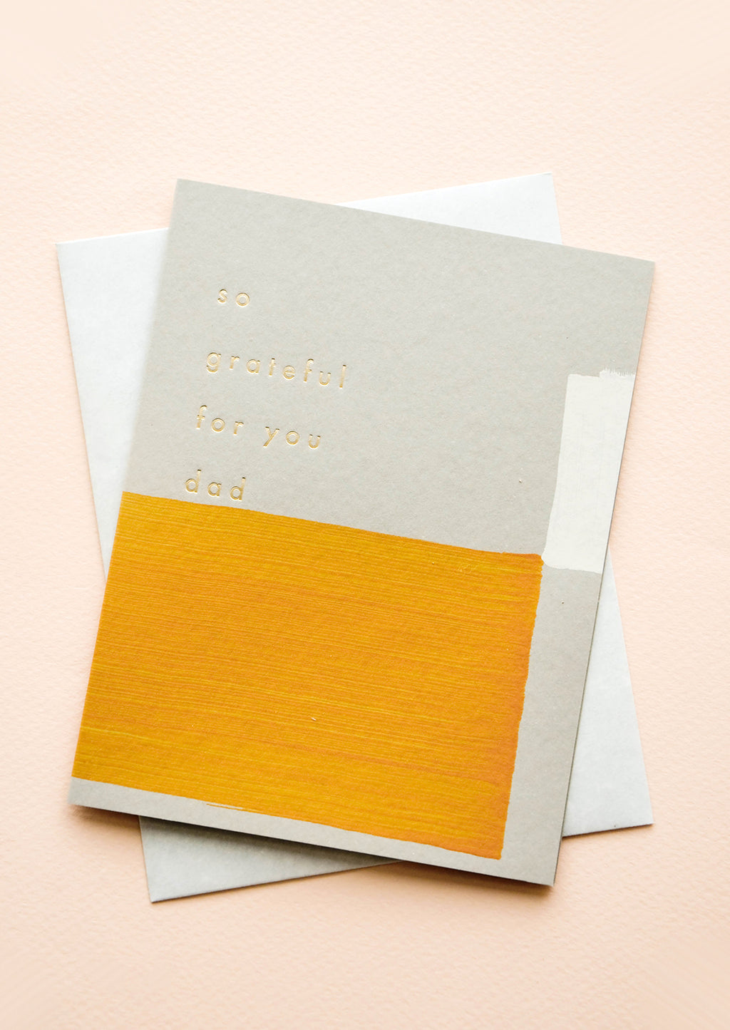 "1: Greeting card with hand-painted square shapes in mustard and white, gold text reads ""So grateful for you dad"""