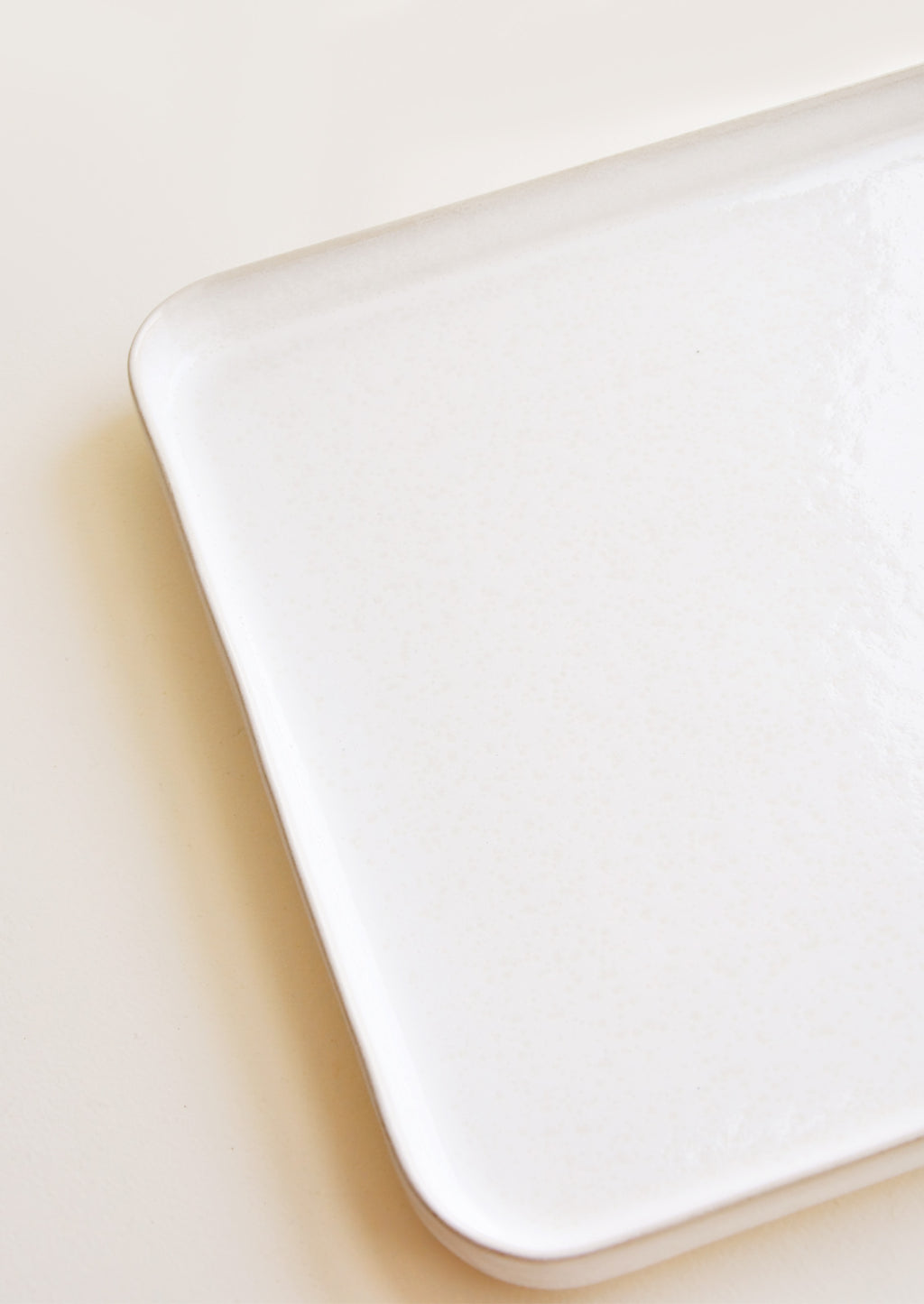 2: Detail of Square Ceramic Tray with Lipped Edge in Ivory.