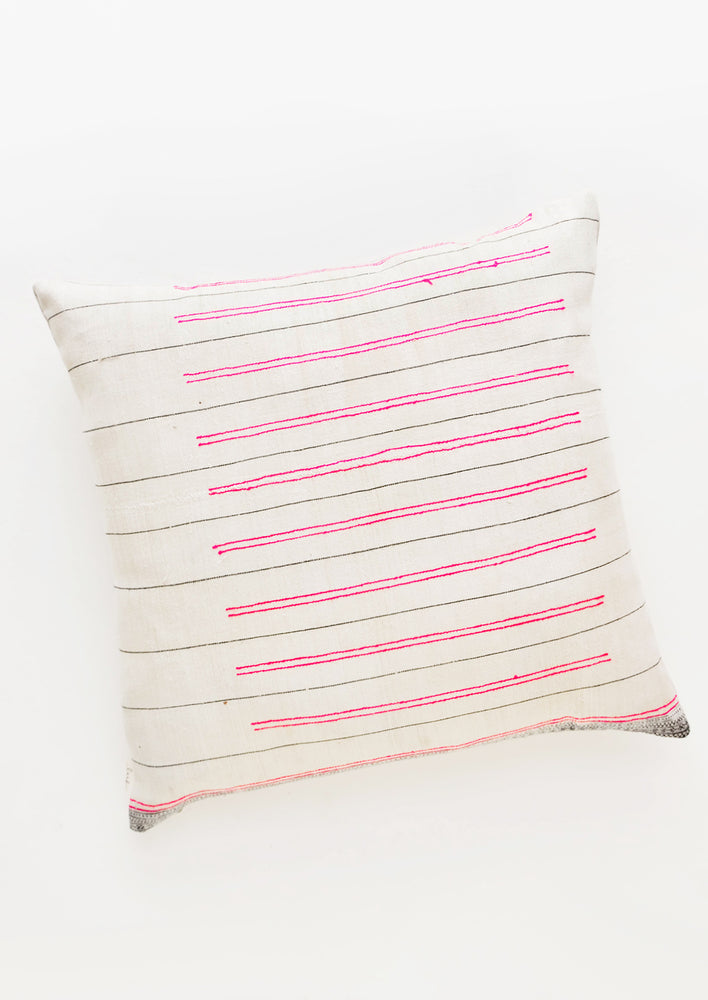 1: Square throw pillow in white fabric with thin black lines and striped hot pink embroidery