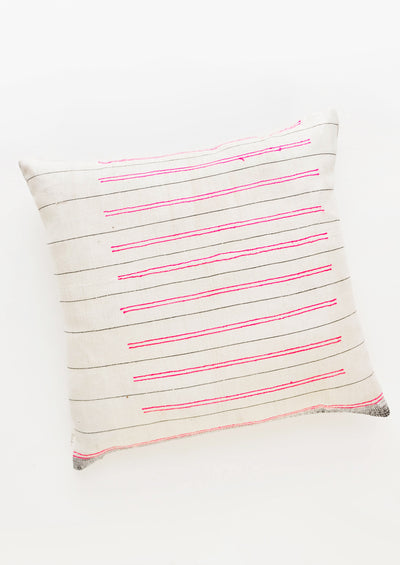 Square throw pillow in white fabric with thin black lines and striped hot pink embroidery