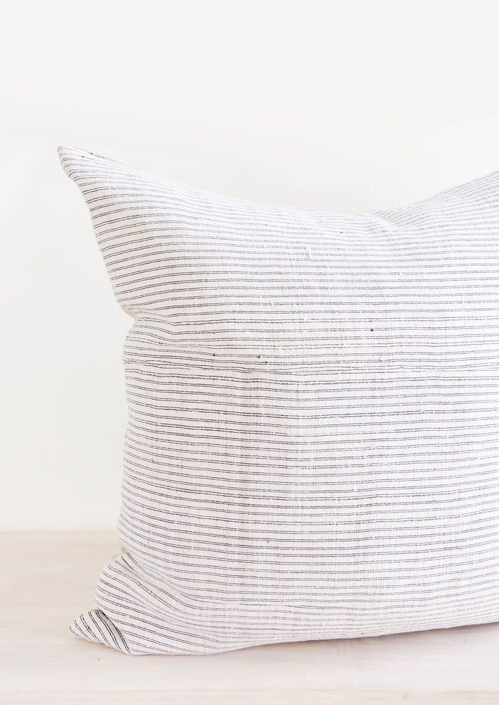 1: Square throw pillow in white hemp fabric with allover thin black stripes
