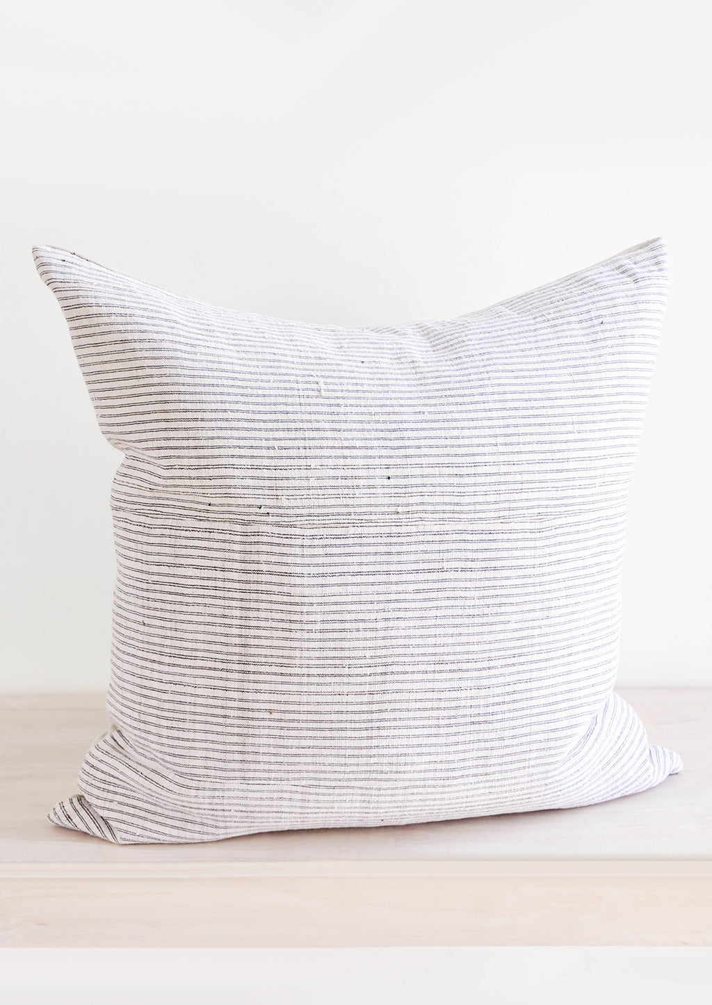 3: Square throw pillow in white hemp fabric with allover thin black stripes