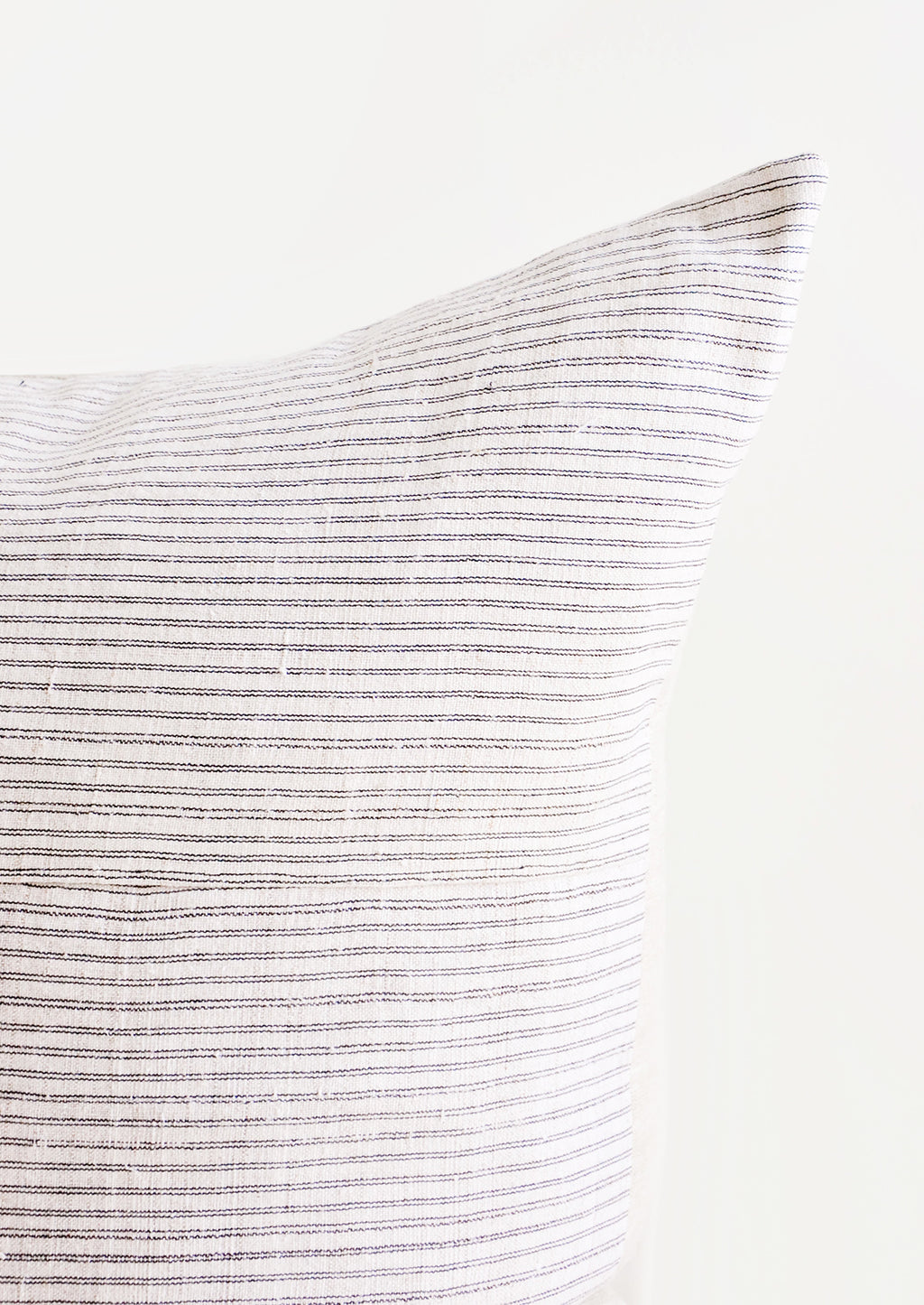 2: Square throw pillow in white hemp fabric with allover thin black stripes