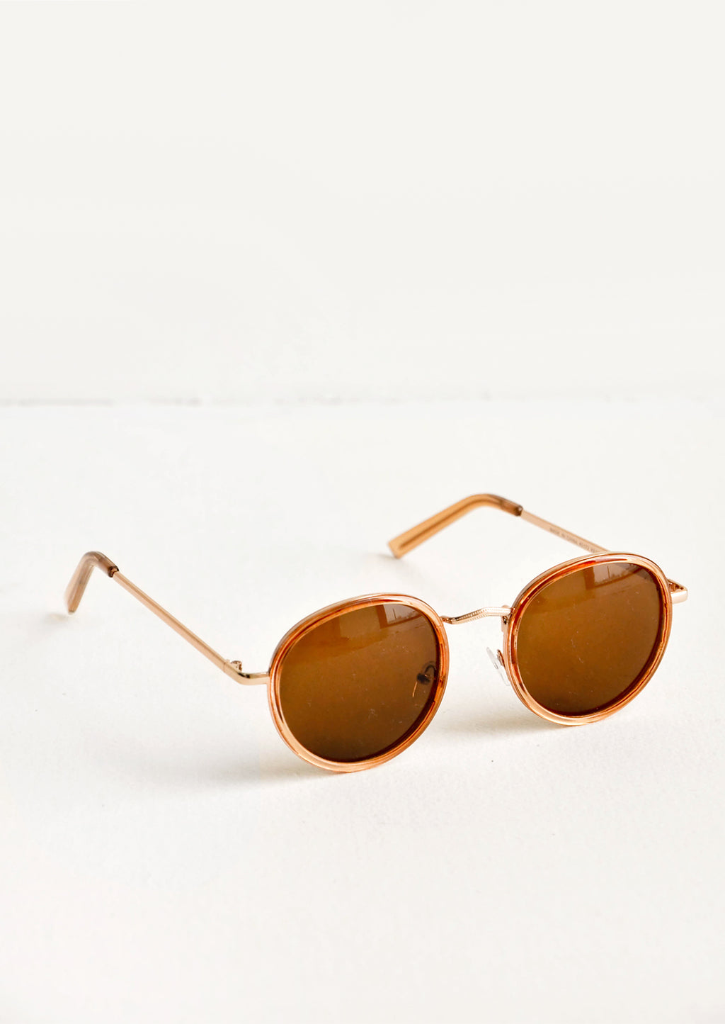Nude: Moon Shot Round Sunglasses in Nude - LEIF