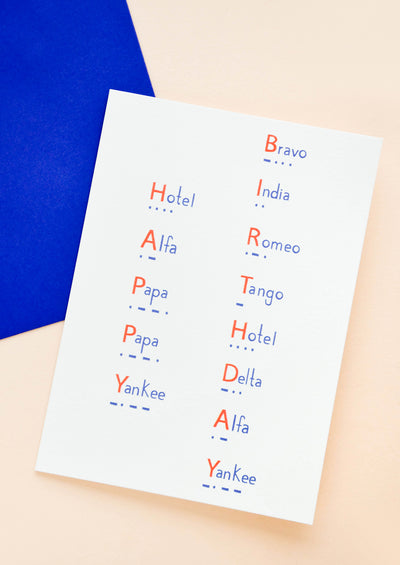 "Greeting card with ""Happy Birthday"" spelled out in morse code in blue and red"
