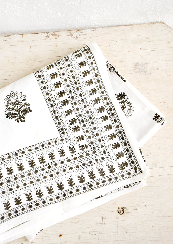 1: Folded cotton tablecloth in white with block printed Indian floral pattern