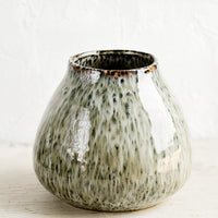 1: A round vase in glossy, speckled green glaze with a tapered opening.