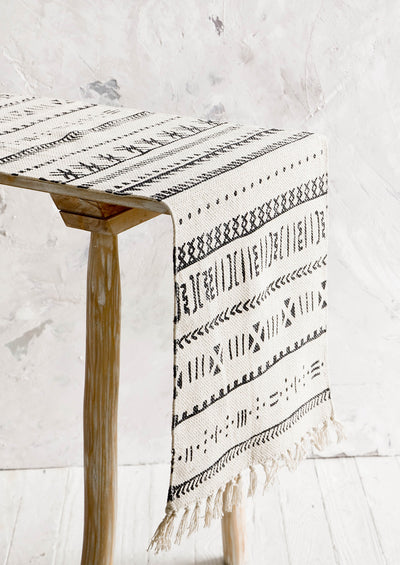 Table runner displayed on a console table, thick canvas material with black geometric print