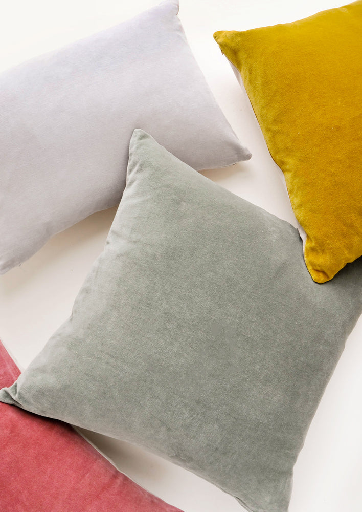 1: Colorful velvet throw pillows scattered together