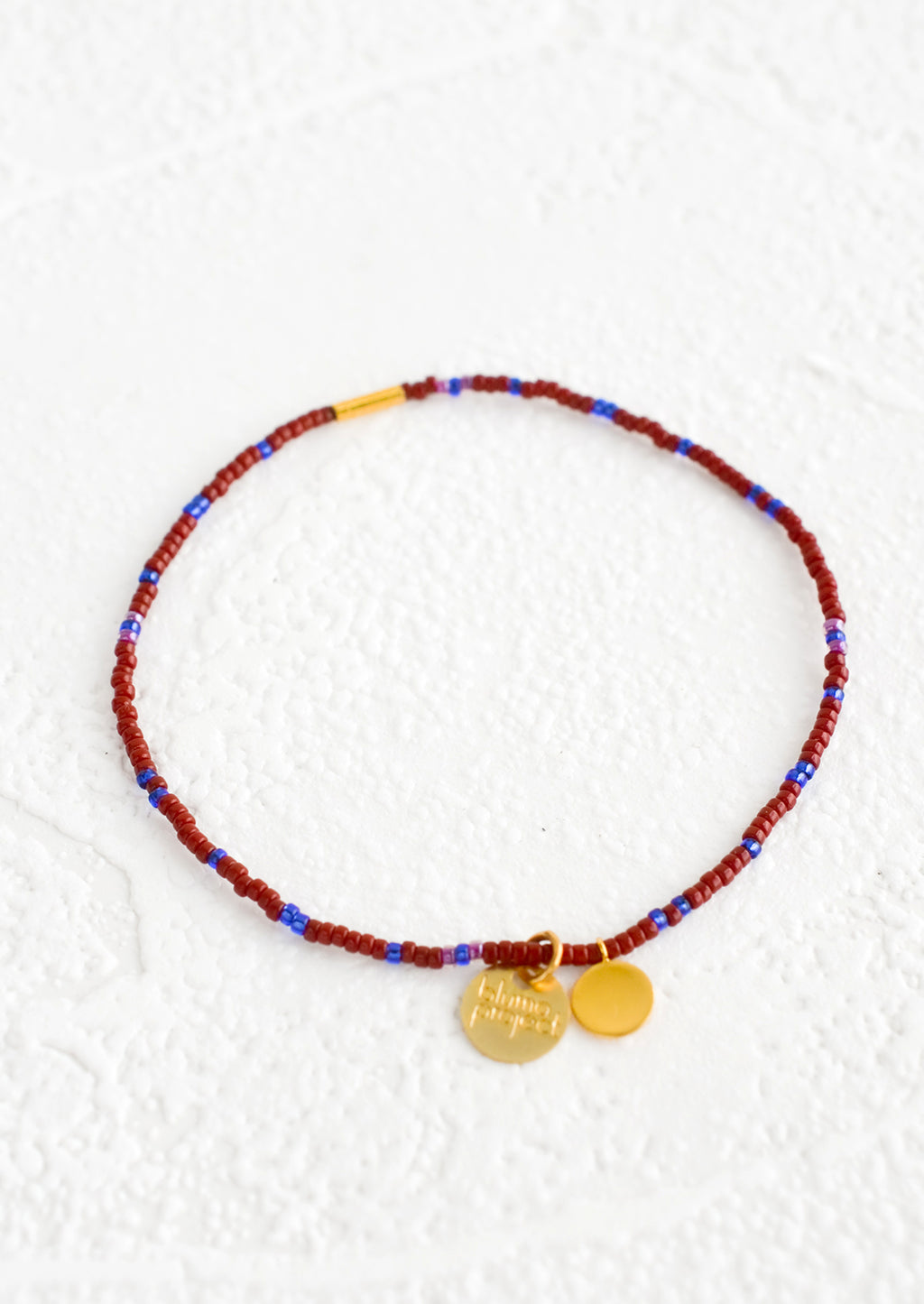 Wine / Cobalt: Seed bead bracelet in wine and blue with brass accents