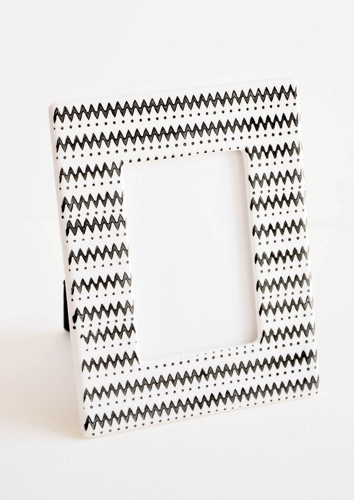 1: White ceramic picture frame with horizontal black zigzag stripes throughout