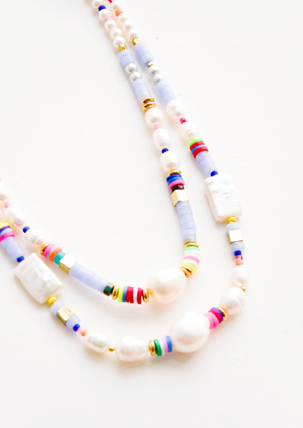 2: A mix of pearl, colorful plastic and gold metal beads on a double strand necklace