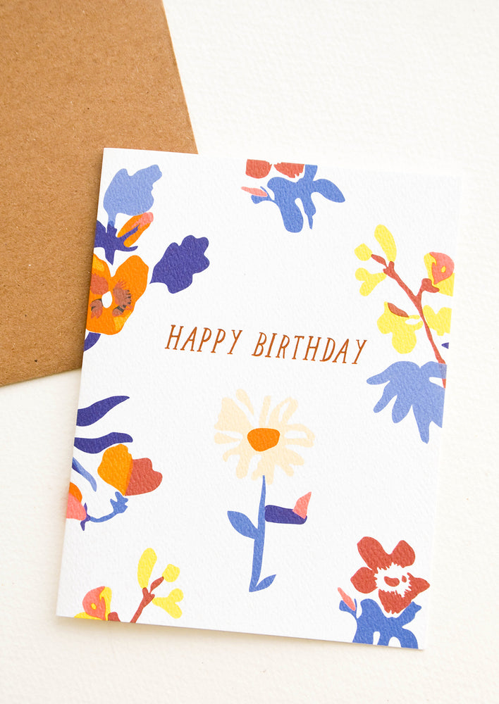 "1: Greeting card with blue and orange flowers, ""Happy Birthday"" in copper text"