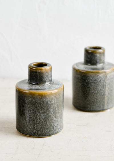 Ceramic taper holders with asymmetric design in reactive glaze.