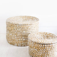 3: Small and large sizes of round, lidded seagrass baskets