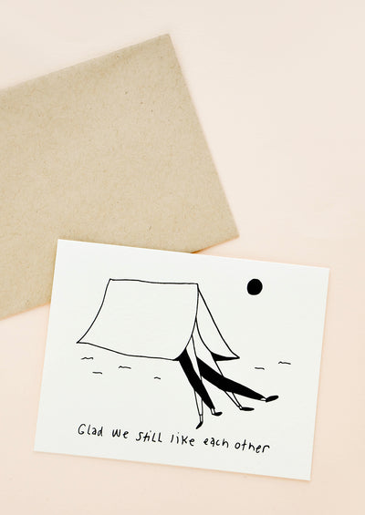 "Greeting card picturing a couple's legs sticking out of a tent, with text underneath that reads ""Glad we still like each other"""