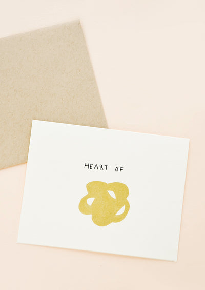 "Greeting card with metallic gold scribble and ""Heart of"" written above it"