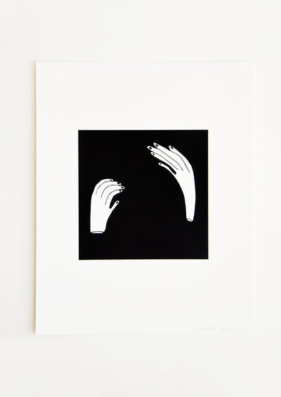Art print with solid black square printed at center, two contorted hands printed in white