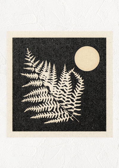 A digital art print with black background and silhouetted fern leaf and moon.