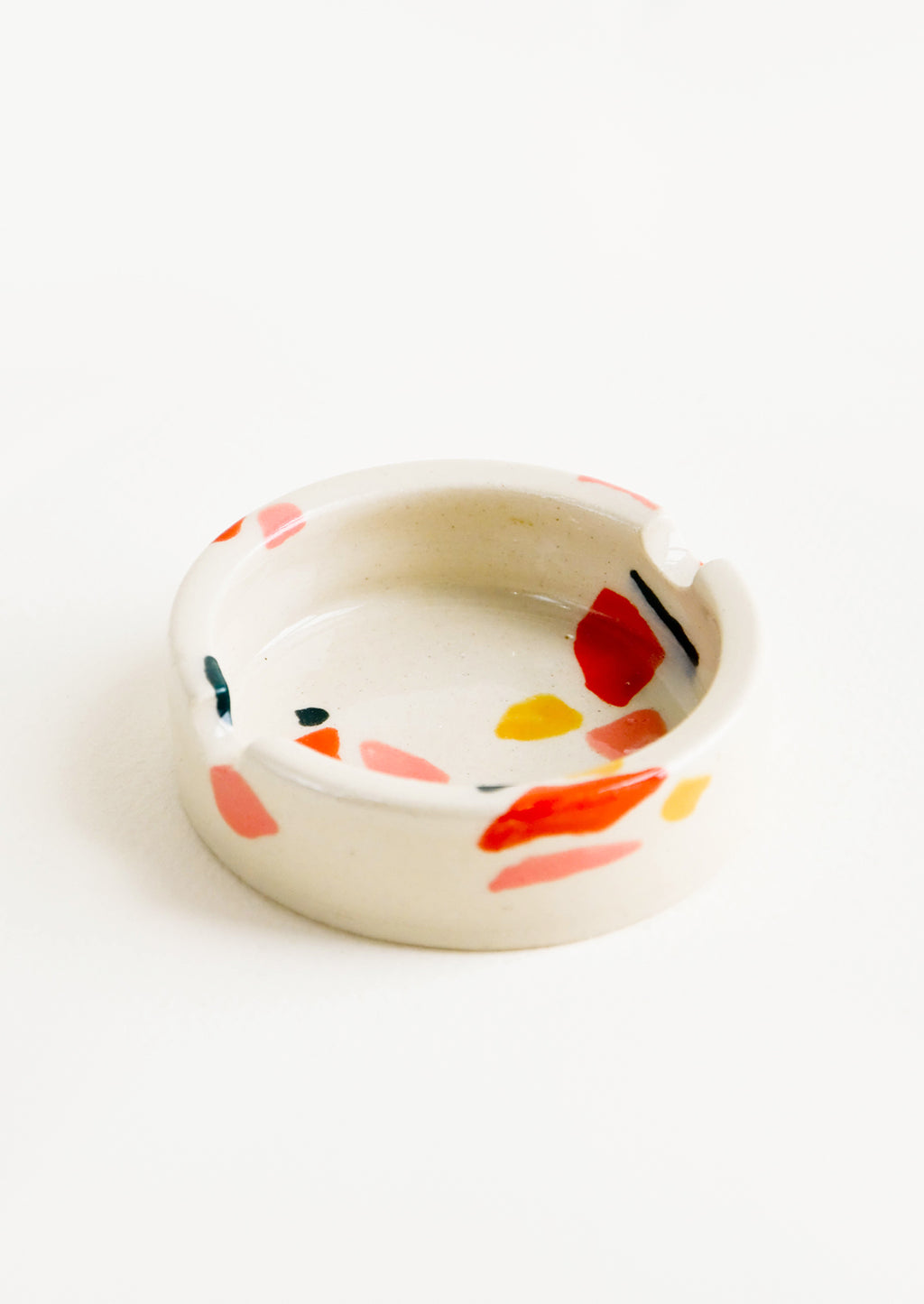 Warm Colors: Ceramic ashtray with allover hand painted terrazzo pattern in a variety of warm colors