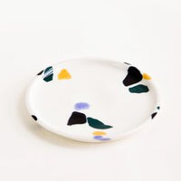 Cool Colors: Small, plate-like ceramic dish in ivory with hand-painted, fragmented pattern in a mix of colors