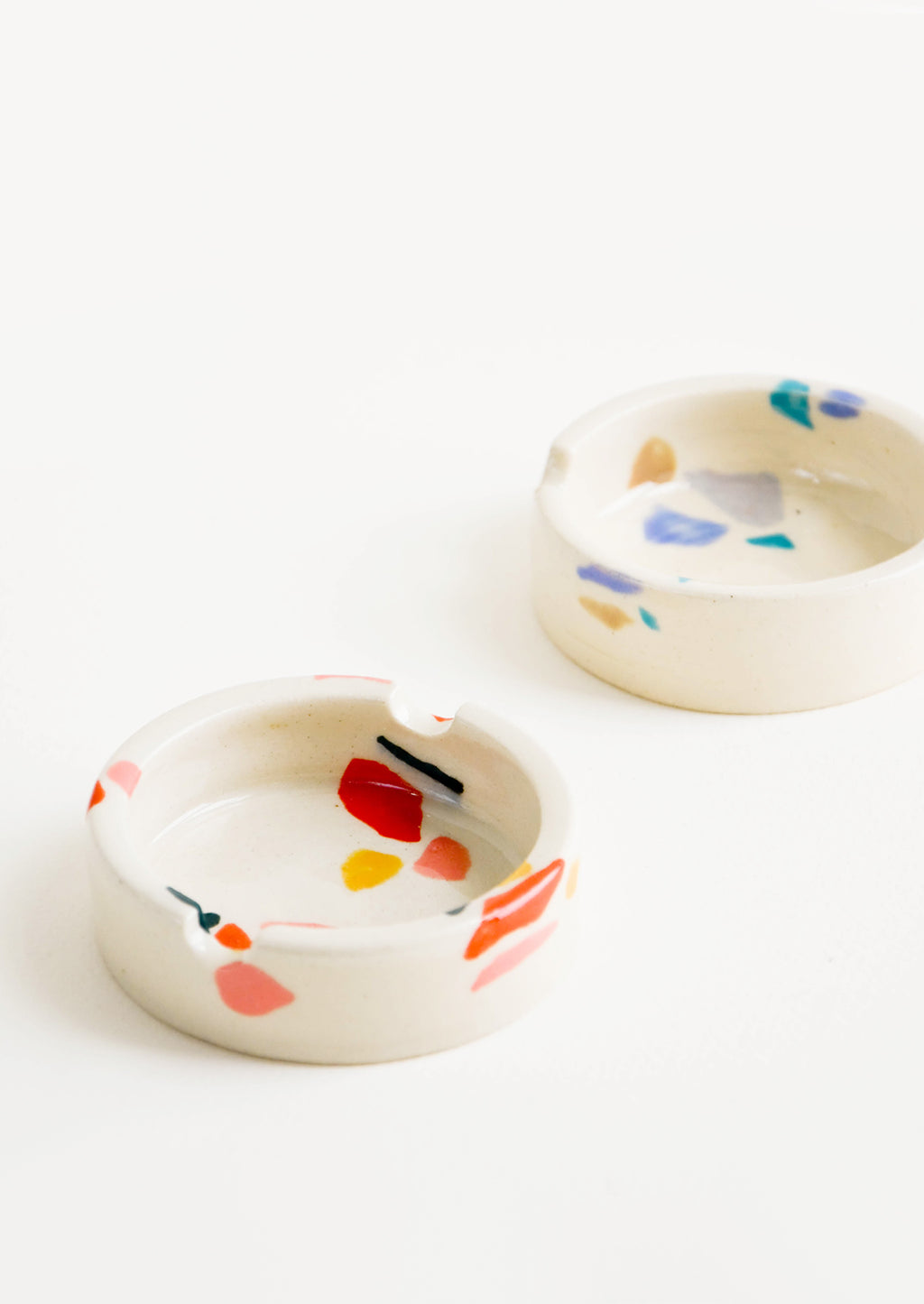 1: Ceramic ashtray with allover hand painted terrazzo pattern in a variety of colors