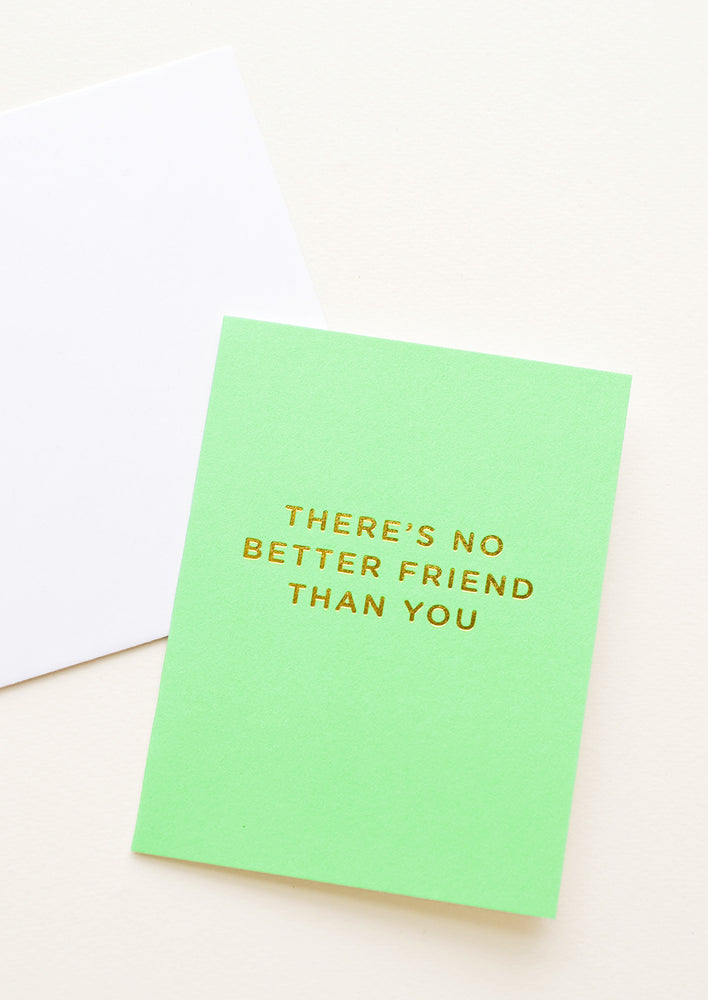 "1: A neon green greeting card with gold foiled text reading ""there's no better friend than you."""