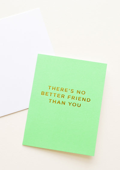 "A neon green greeting card with gold foiled text reading ""there's no better friend than you."""