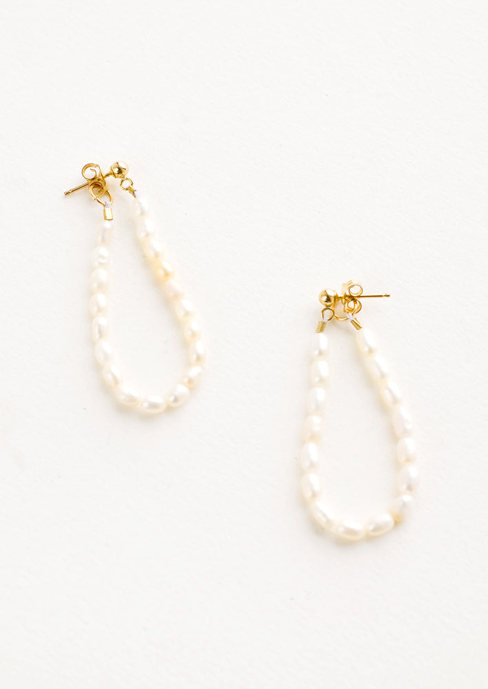 1: Pearl string earrings with two-sided post back closure that goes from the front to the back of the ear