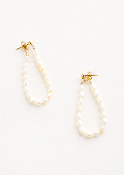 Pearl string earrings with two-sided post back closure that goes from the front to the back of the ear