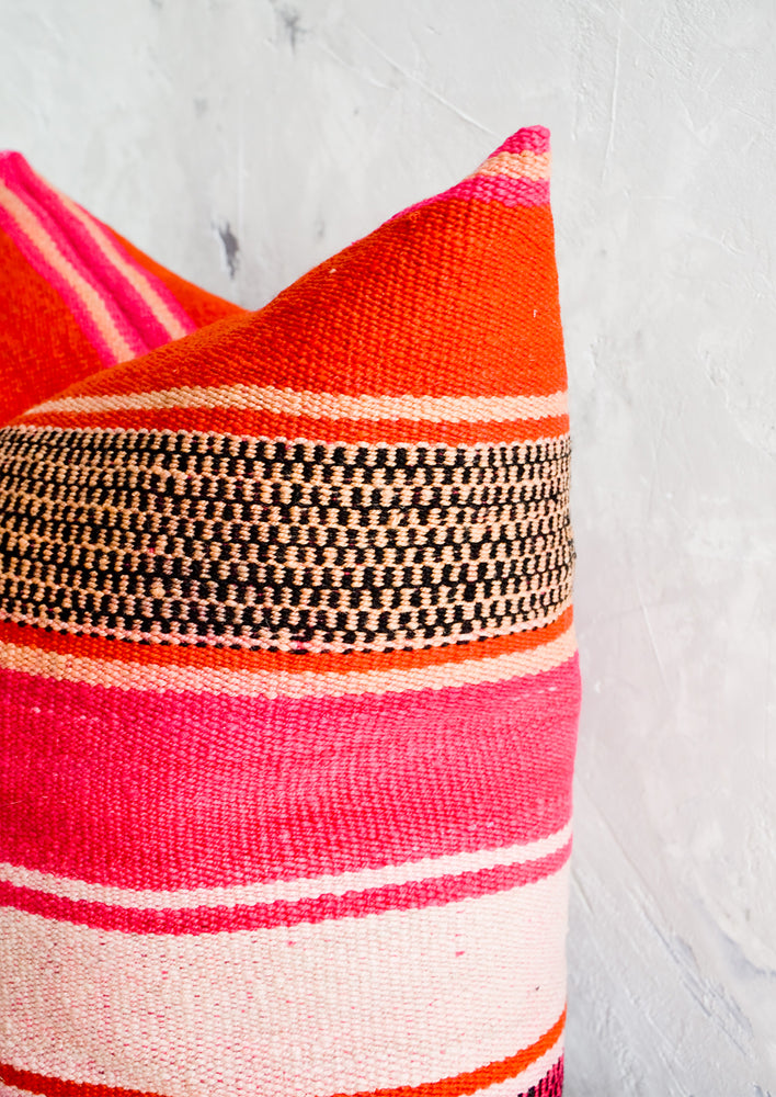 2: Throw pillow made from vintage striped wool in vibrant pink, orange and peach