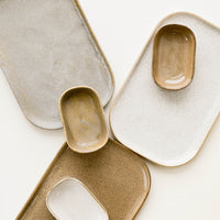 1: Array of Ceramic Trays & Sauce Dishes in Earth Tones.