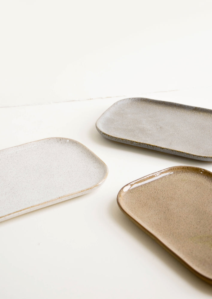 5: Trio of ceramic trays in earth tones.