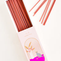 Sandalwood: Pink box slid open with incense sticks scattered to the side