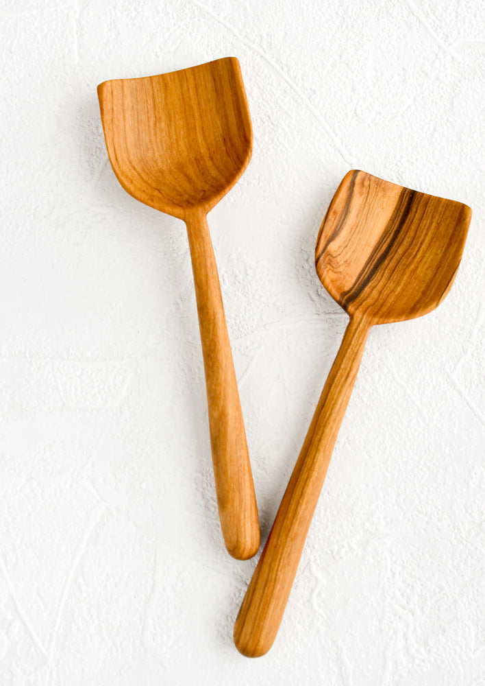 2: Two hand carved wooden spoons with a shovel-like shape.