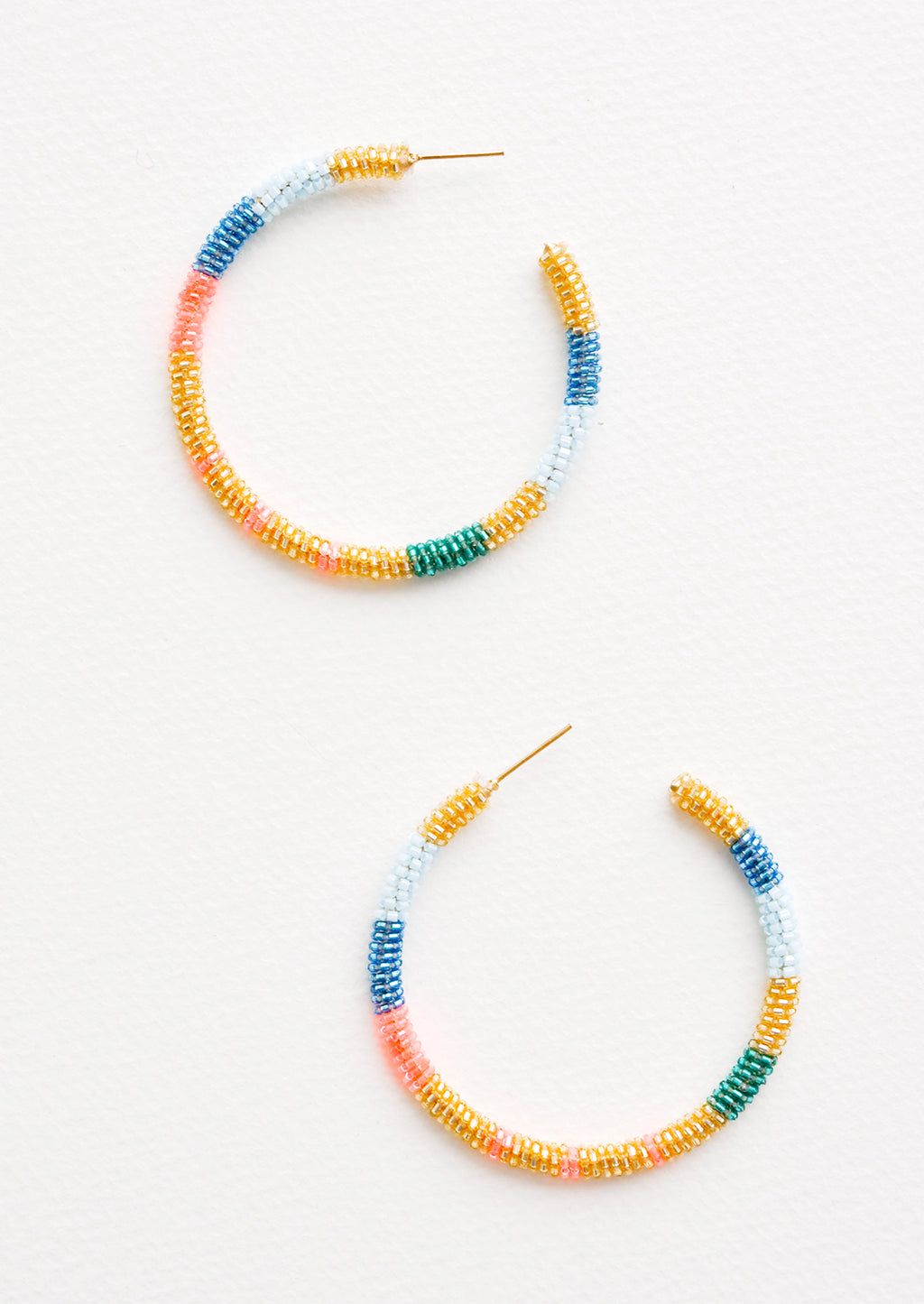 Blue / Gold Multi: Hoop earrings with blue, pink, gold and green glass beads arranged in a circle.