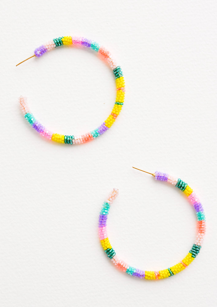 Pink / Yellow / Aqua Multi: Hoop earrings with pink, yellow, aqua and purple glass beads arranged in a circle.