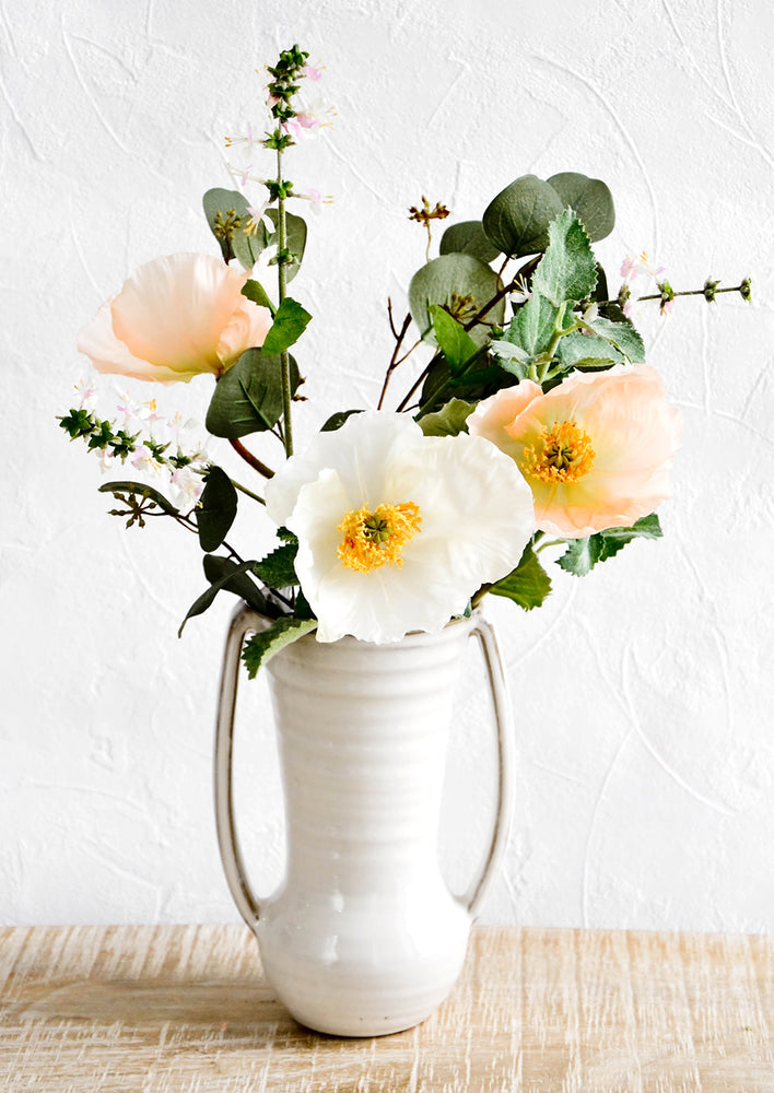 2: Glossy ceramic vase with side handles, housing floral bouquet with poppies and wild basil flowers