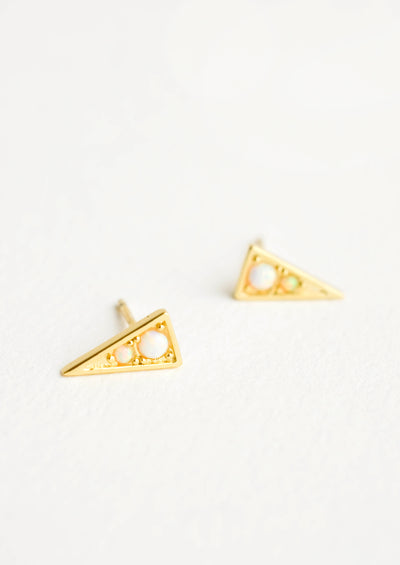 Gold colored stud earrings in shape of pointy triangle with round opal stone inset.