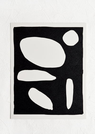 Art print of abstract white shapes on black background with white border.